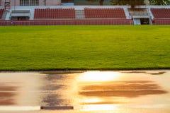 在体育场反射的轨道太阳早晨,曼谷在泰国 免版税库存照片