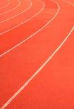 在体育运动体育场内运行跑道 免版税库存照片