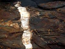 在佩勒姆海湾公园的岩石 库存照片