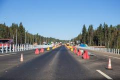 在俄国联邦高速公路A-181斯堪的那维亚的重建的建筑工作 免版税库存图片