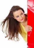 在俏丽的购物白人妇女的背景 免版税库存照片