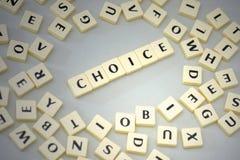 在信件附近发短信给在灰色背景的选择 免版税库存图片