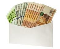 在信包的货币 免版税库存照片