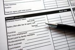在信用申请书的收入标题 免版税库存照片