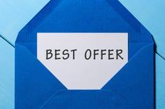 在信件的最佳的提议题字在蓝色信封 概念玻璃现有量扩大化的销售额 免版税库存图片