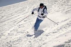 在倾斜的人滑雪 图库摄影