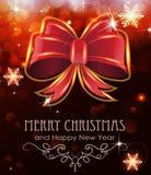 在假日背景的红色圣诞节弓 免版税库存照片