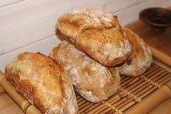 在做的法语上添面包 库存图片