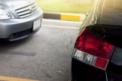 在停车场的汽车中止 图库摄影