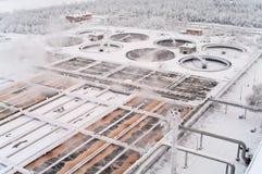 在储水箱的污水处理在冬天 免版税库存照片