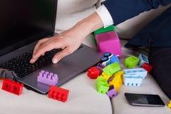 在儿童的玩具中的商人 免版税库存照片