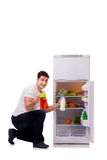 在充分冰箱的人食物旁边 库存照片