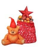 在充分圣诞老人袋子的玩具熊玩具玩具附近 免版税库存图片