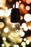 在光亮背景的老灯 免版税库存图片