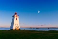 在光的灯塔从月亮和星期日 免版税库存图片