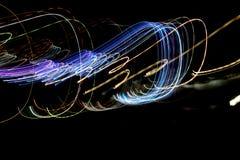 在光线影响做的行动的多彩多姿的镶边线,光落后 库存照片