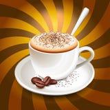 在光芒的热奶咖啡杯子 库存图片