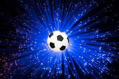 在光芒背景的足球 库存图片