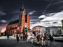 在克拉科夫老镇的跳舞云彩 免版税图库摄影