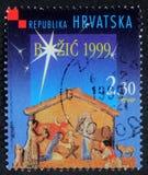在克罗地亚打印的圣诞节邮票显示圣诞节托婴所 库存照片