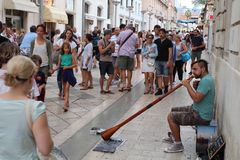 在克罗地亚/街道艺人的旅游业 免版税库存照片