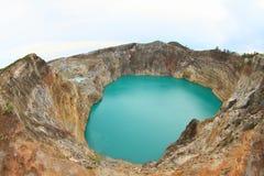 在克里穆图火山的火山-独特的湖装罐并且轻拍 免版税库存图片