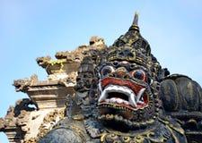 在入口的可怕石barong面具对Tanah全部,巴厘岛 免版税库存图片