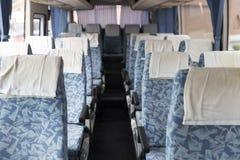 在公共汽车的蓝色织品车位子 免版税库存照片