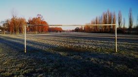 在公园操场的橄榄球目标 库存图片