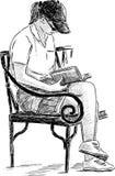 在公园长椅的女孩读书 库存照片