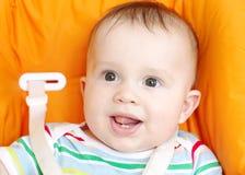 在六个月婴孩的第一颗牙 免版税库存照片