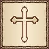 在典雅的背景的基督徒十字架与金银细丝工的框架 免版税库存图片