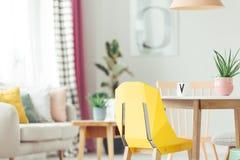 在内部的黄色设计师椅子 库存照片