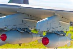 在军事航空轰炸机的两颗炸弹 图库摄影