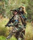 在军服的精神有武器的 免版税图库摄影