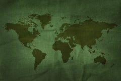 在军队织品纹理的世界地图 免版税图库摄影