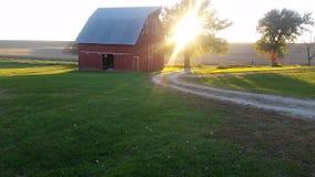 在农场的日落 免版税库存图片