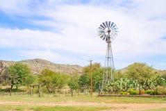 在农场的风车在纳米比亚 库存图片