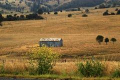 在农村农场流洒的农场 免版税图库摄影