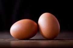 在农村桌面的两个有机鸡蛋 库存照片