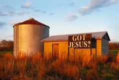 在农舍的标志:得到的耶稣 免版税库存照片