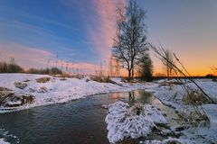 在冬天域的日落 库存照片