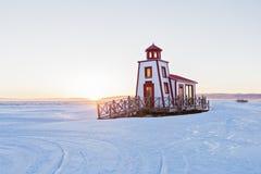 在冬天季节的灯塔 库存图片
