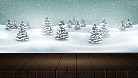 在冬天森林风景前面的空的木桌 免版税库存图片