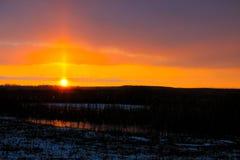 在冬天河的日落 免版税图库摄影