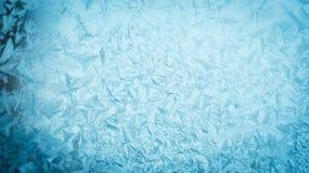 在冬天玻璃窗的冷淡的圣诞节样式 免版税库存照片