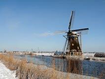 在冬天设置的风车 免版税图库摄影