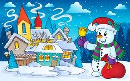 在冬天风景的圣诞节雪人 免版税库存图片