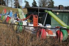 在冬天风雨棚的出租脚蹬小船 库存照片