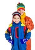 在冬季体育衣物的两个孩子 图库摄影